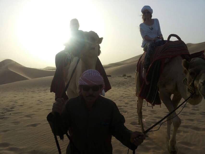 riding a camel in the desert